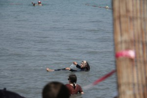 a Muslim woman floating in the Dead Sea
